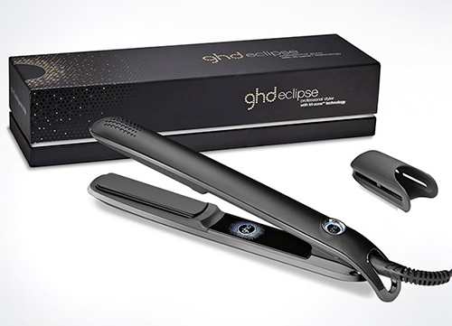 Picture of the GHD eclipse straighteners including a box and product accessories, item is black