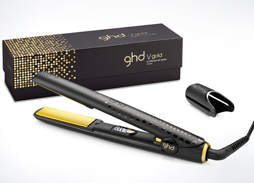 GHD hair straighteners with box and attachment displayed from the front to show product.